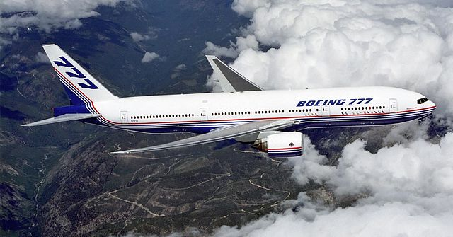 A Boeing 777 in flight over the mountains (From Wikipedia)