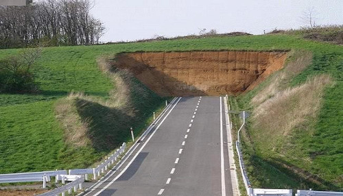 A road going straight in a wall