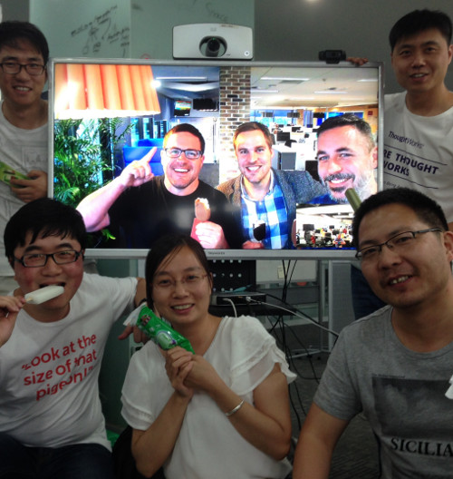 A team sharing food remotely between offices