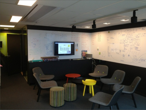 Team gathering area with writable walls and a wall screen at spotify