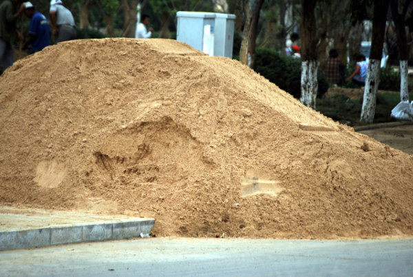 A sand pile on the pavement