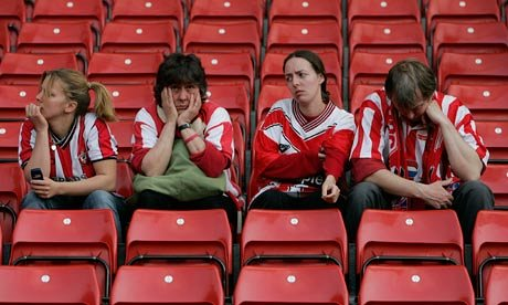 A team of sad fans, looking like lost zombies