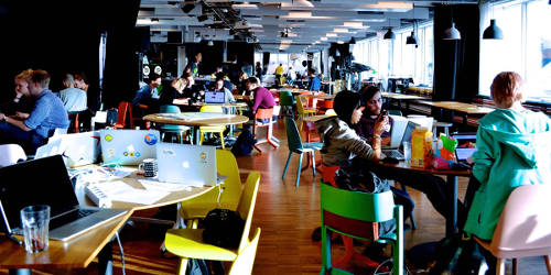 A photo of Spotify's open space during a Hackathon