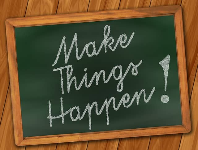 """Make things happen"" written on a blackboard"