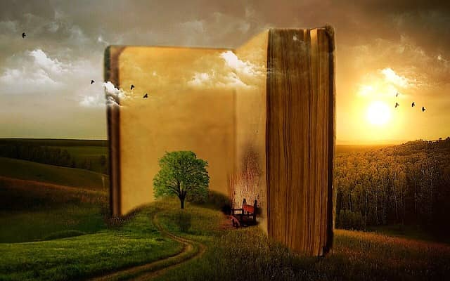 Made up image of a giant open book in the middle of the countryside. Storytelling is key to successful DDD Event Storming