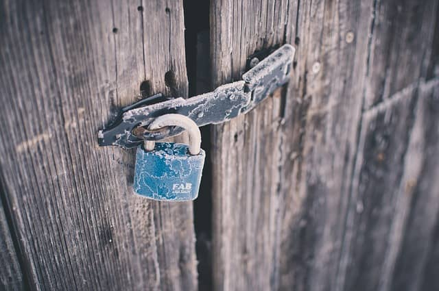 A picture of a locked door. Domain Driven Design can remain shut to people because of its awkward vocabulary. Many people will judge it too abstract and only work astronaut architecture.
