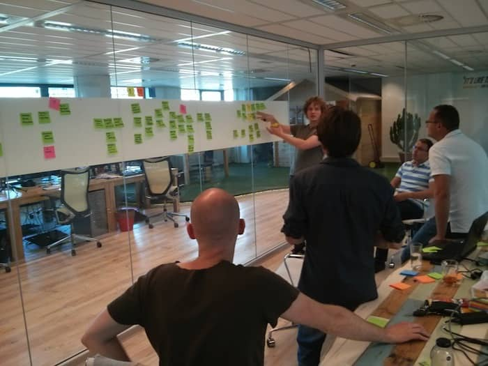 Photo of an event storming. This workshop grew out of the DDD community and is an accelerator to share knowledge between domain and technical experts. As technical experts, Data Scientist should benefit from it too!