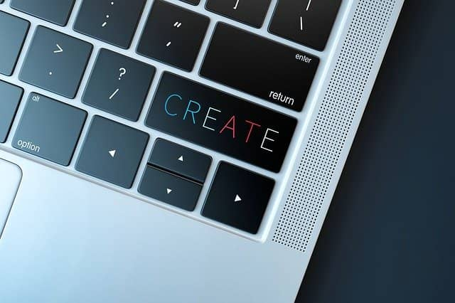 Photograph of a keyboard with the 'SHIFT' key replaced by a 'CREATE' key. Growing an Agile Technical Coaching offer is a creative endeavor, like an internal startup