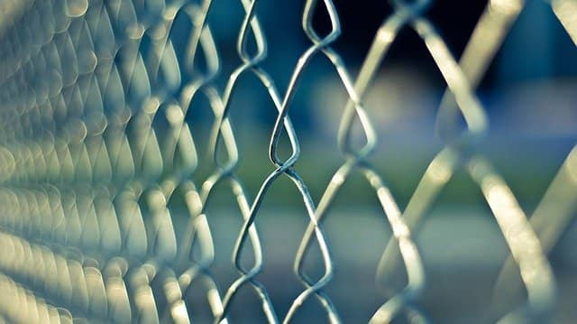 Close up photograph of a chainlink. There are barriers to overcome when starting TDD for Legacy Code