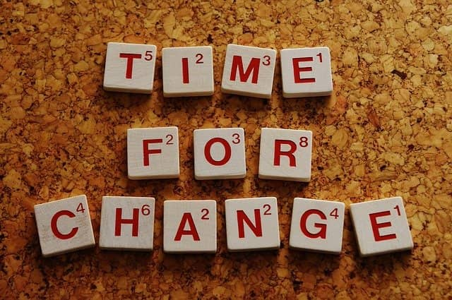 Photograph of scrabble letters forming the word 'Time for a change'. As technical agile coach, we bring change. Change is not easy most of the time.