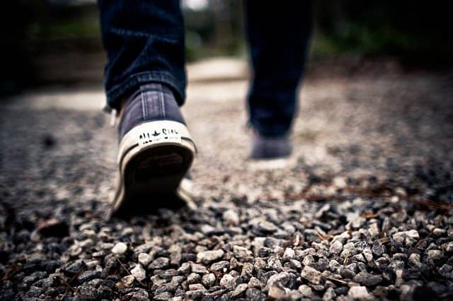 Photograph of someone walking. Gemba, or walking in the team's shoes, is a powerful change management recipe that can help you to understand the special challenges that the team is facing. This will help down the road to manage the team's resistance to change.