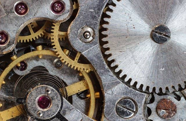 Photo of the inner gears of a clock. As a member of your current organization, you already know many of its inner working. You can use this at your advantage to get technical coaching started.
