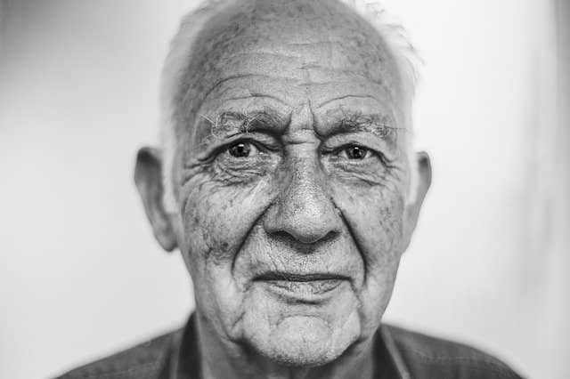 """Photo of a smiling old man that could be an experienced coach. Emily Bache's """"Technical Agile Coaching with the Samman Method"""" book contains tons of advice that could be useful to even the most experienced technical coach."""