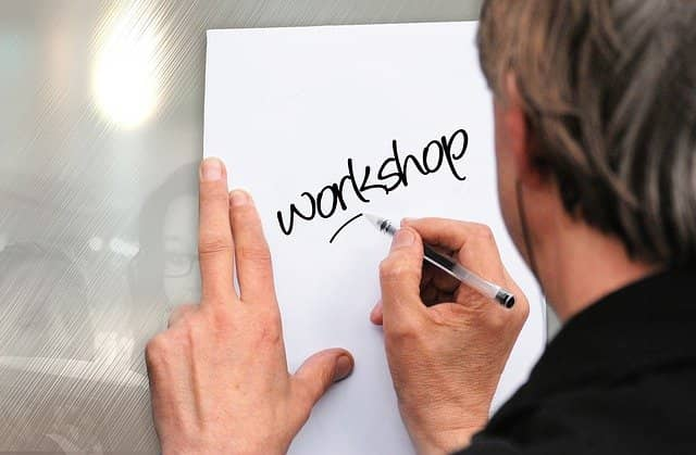 Picture of a man writing 'workshop' on a whiteboard on the wall. Example-Mapping is a very lightweight conversation format to capture the details of a user story.