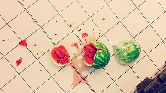 Photo of a watermelon, shattered after it fell on the floor